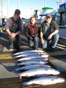 Capt. Pete, Erica, andf Capt. Ron with a limit of king salmon
